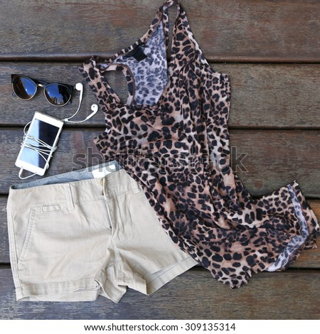 Woman's basic summer fashion - chino shorts with animal printed shirt - stock photo