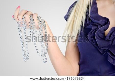 Woman's bead on grey background - stock photo