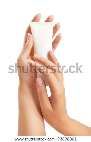 Woman's beautiful hands with care cream tube on the white background - stock photo