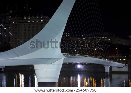 Woman's Bridge is a footbridge in Puerto Madero comercial district of Buenos Aires, Argentina. - stock photo