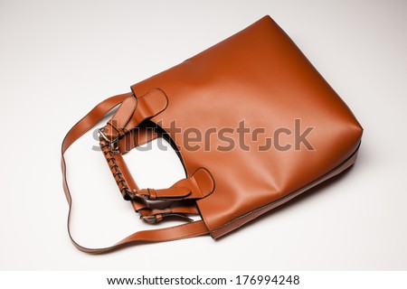 woman's brown bag over white, top view - stock photo