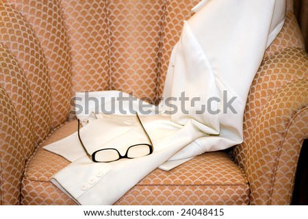 Woman's Coat and Eye Glasses on Seat