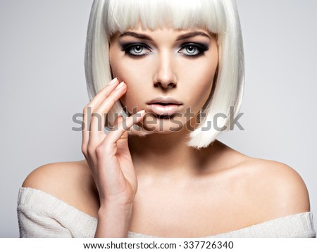 Woman's face with  fashion black makeup of eye and long black eyelashes. Studio. Closeup. - stock photo