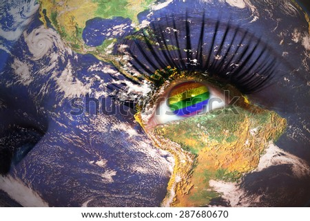 woman's face with planet Earth texture and gay flag inside the eye. Elements of this image furnished by NASA. - stock photo