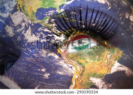 woman's face with planet Earth texture and hungarian flag inside the eye. Elements of this image furnished by NASA. - stock photo