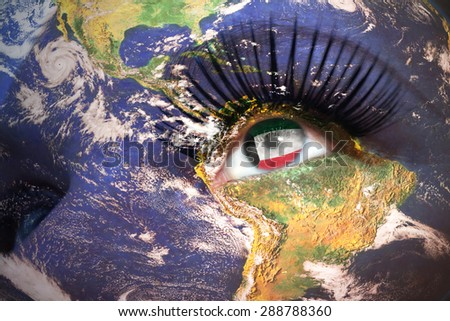 woman's face with planet Earth texture and kuwait flag inside the eye. Elements of this image furnished by NASA. - stock photo