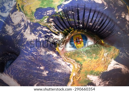 woman's face with planet Earth texture and madeira flag inside the eye. Elements of this image furnished by NASA. - stock photo