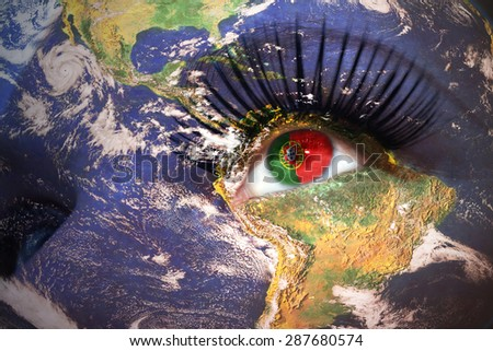woman's face with planet Earth texture and portuguese flag inside the eye. Elements of this image furnished by NASA. - stock photo
