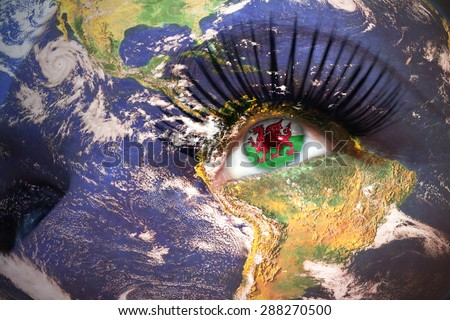 woman's  face with planet Earth texture and welsh flag inside the eye. Elements of this image furnished by NASA. - stock photo