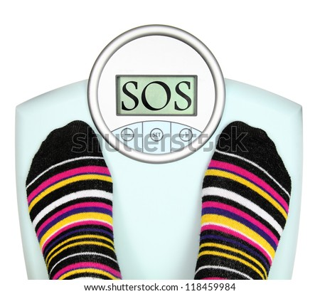 Woman' s feet on weighing scale - stock photo