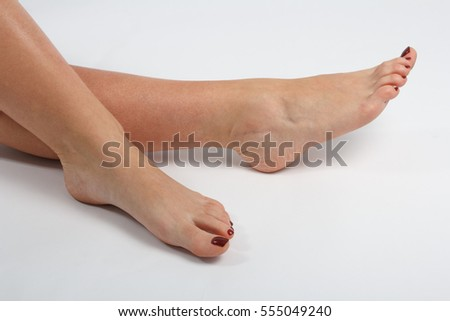 Woman's feet with red nail polish