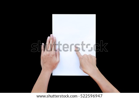 Woman's finger pointing and touching on paper isolated on black background, Education concept.
