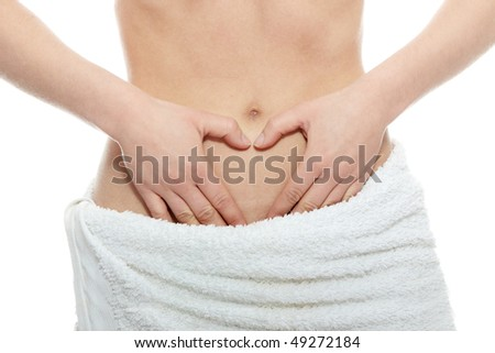 Woman's Fingers Touching her body parts, heart shaped fingers - stock photo
