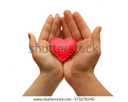 woman's hand and man's hand together   hold a red heart, isolated  on white background