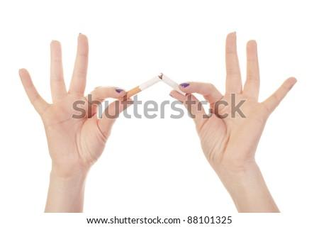 Woman's hand crushing cigarettes - stock photo