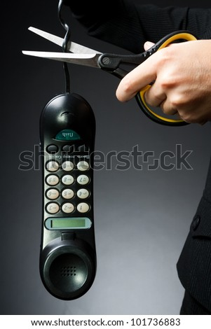 Woman's hand, cut off the phone with scissors (business-deprivation issue of communication)