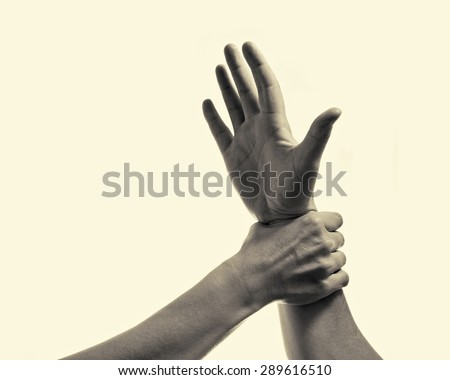woman's hand gripping his hand stopping male aggression - stock photo