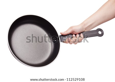 Woman's hand holding a frying pan isolated on white - stock photo