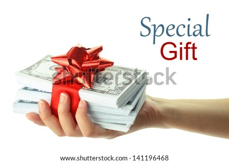 Woman's hand holding a gift of money - stock photo