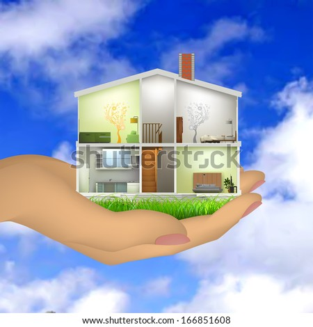 Woman's hand holding a house cut with interiors - stock photo