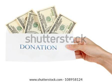 Woman's hand holding an envelope with money on white background - stock photo