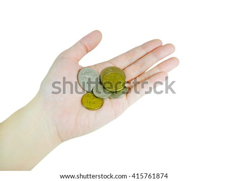 Woman's hand holding Australian coins (with clipping path) - stock photo