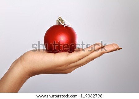 woman's hand  holding balls. isolated on white background