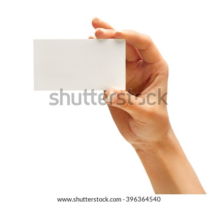 Woman's hand holding business card isolated on white background. Close up - stock photo