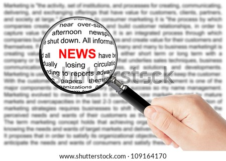 Woman's hand, holding classic styled magnifying glass, with News word - stock photo