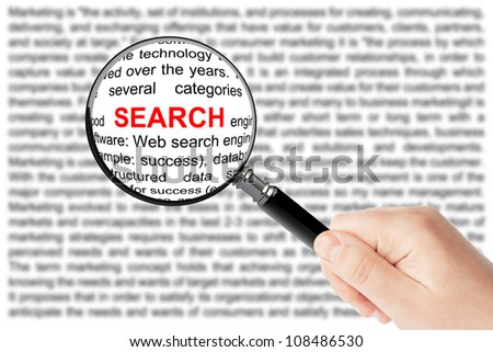 Woman's hand, holding classic styled magnifying glass, with search word