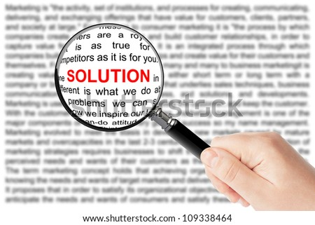 Woman's hand, holding classic styled magnifying glass, with Solution word - stock photo