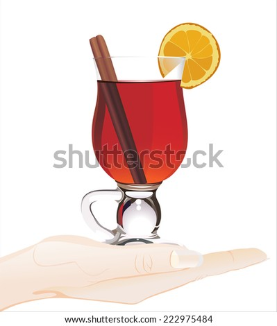 Woman's hand holding object-Hot mulled  - stock photo