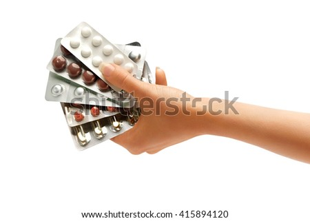 Woman's hand holding pills plates isolated on white background. Close up. High resolution product. Healthcare concept - stock photo