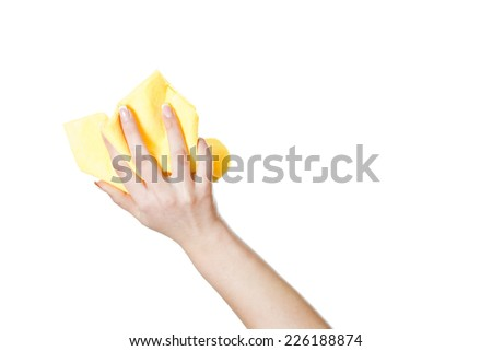 Woman's hand holding rag isolated on white background - stock photo