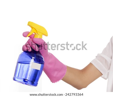 Woman's hand holding sprayer - stock photo