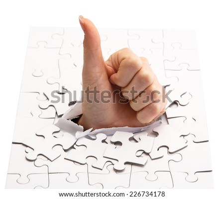 Woman's hand in the puzzle - stock photo