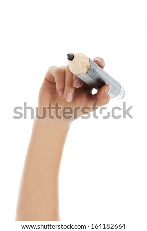 Woman's hand is holding big pencil and writing on copy space.  Isolated on white.  - stock photo