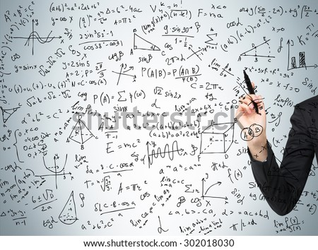Woman's hand is pointing out the complicated math calculations. Math formulas are written on the glass screen. - stock photo