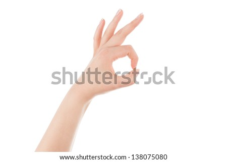 Woman's hand is showing OK sign on a white background.