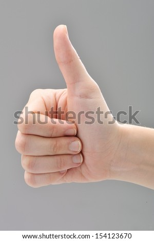 Woman's hand making sign - stock photo