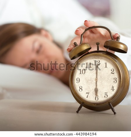 Woman's hand off the alarm clock, 6 am