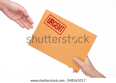 woman's hand passes the envelope male hand. yellow envelope in the hand isolated on white background. Urgent symbol.