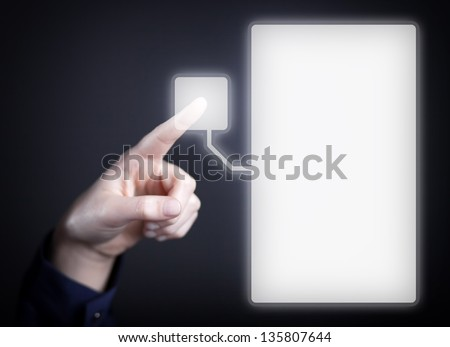 Woman's hand pushing the button on touch screen. Choice concept
