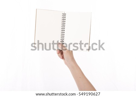 woman's hand showing blank book