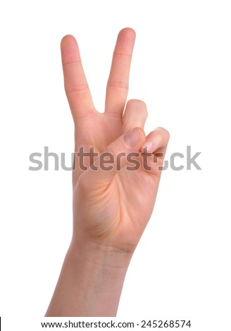 woman's hand showing two fingers that create sign of victory - stock photo