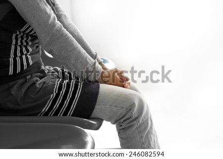 Woman 's hand waiting for doctor in hospital - stock photo