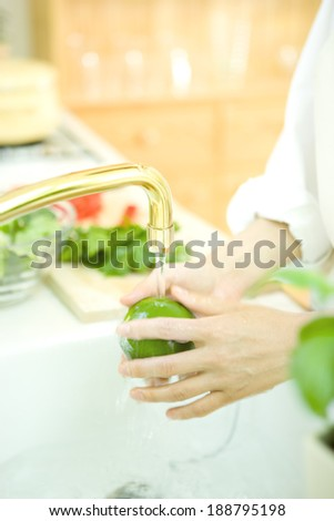 Woman's hand washing lime