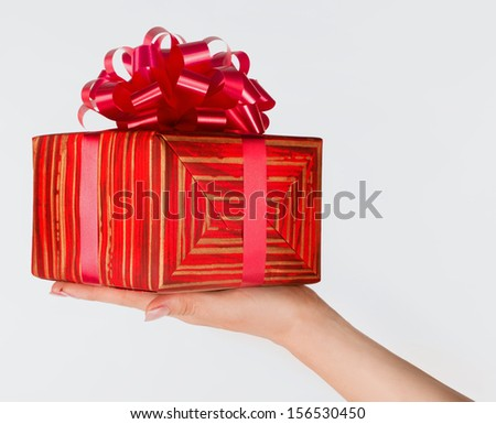 Woman's hand with a gift
