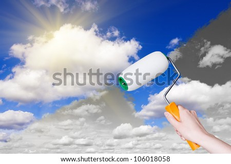 woman's hand with a paint roller - stock photo