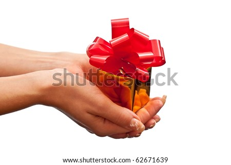 Woman's hand with a small gold gift box with bow isolated on white background - stock photo